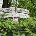 Old sign post pointing down in the direction of Ravenswick Hall