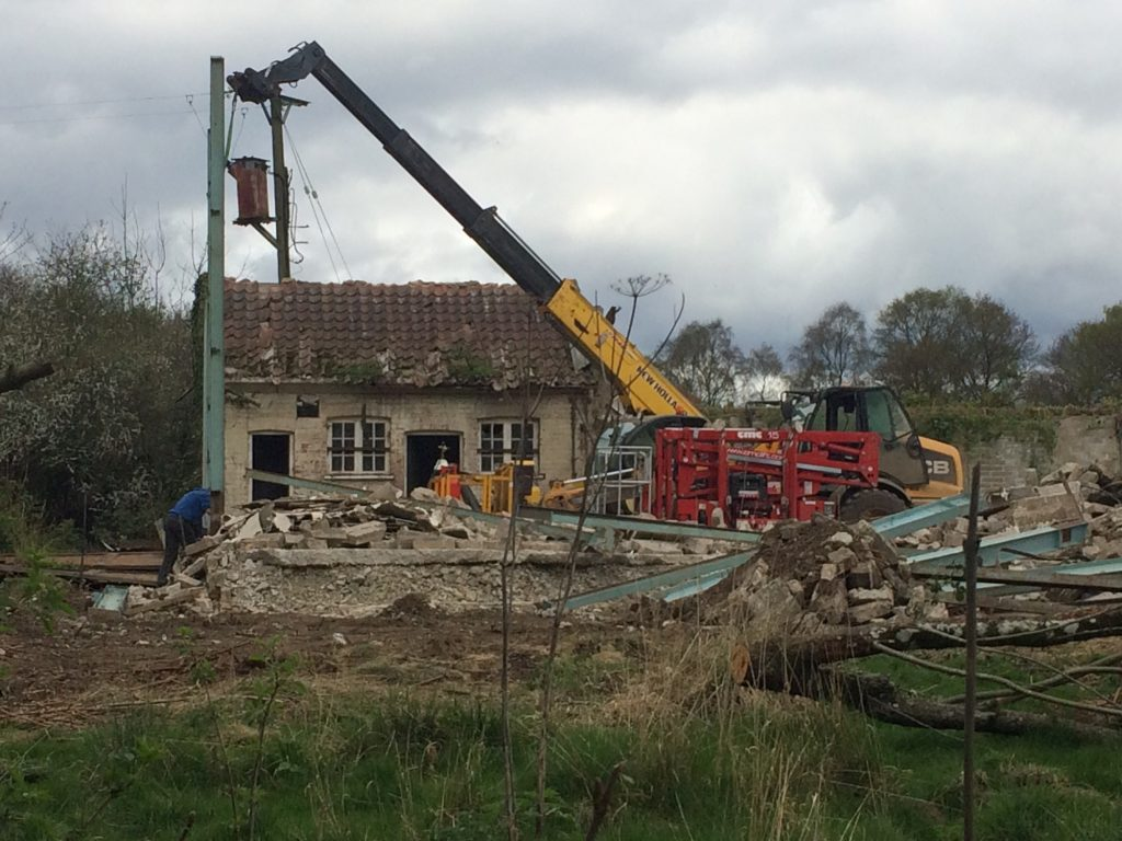 Demolition team at work at Ravenswick Hall